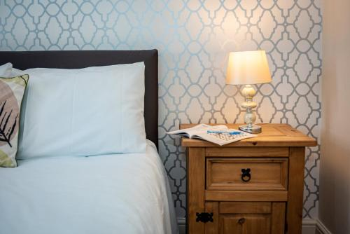 A bed or beds in a room at Waterview Deluxe Apartments