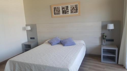 Posteľ alebo postele v izbe v ubytovaní Advise Hotels Reina