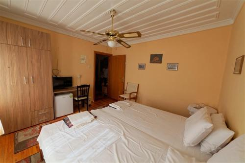 A bed or beds in a room at Kavala Rooms