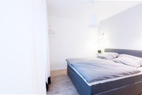 Ein Bett oder Betten in einem Zimmer der Unterkunft Köhlz Fewo & Restaurant