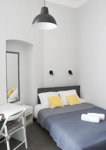 Łóżko lub łóżka w pokoju w obiekcie Peregrinus Rooms & Apartments
