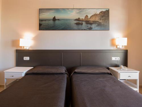 A bed or beds in a room at Fuengirola Beach Apartamentos Turísticos
