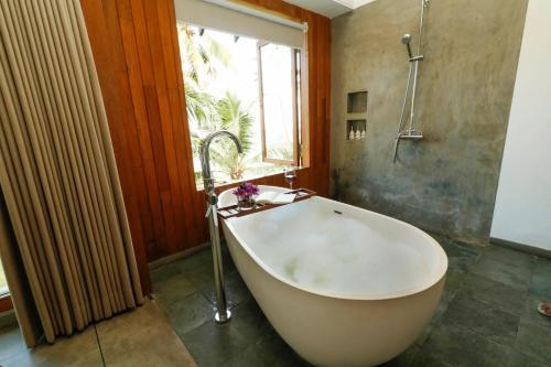 A bathroom at Ubuntu Beach Villas by Lantern