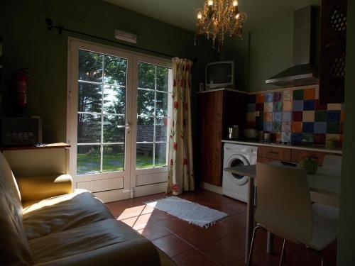 A kitchen or kitchenette at Apartamento Guidan