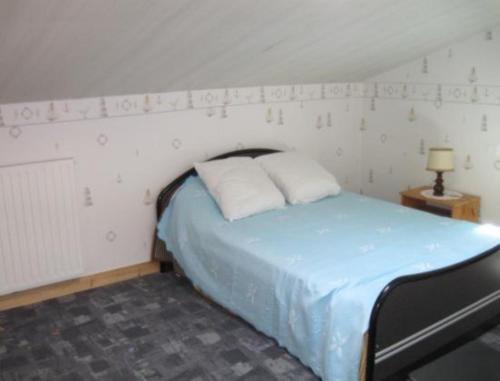 Un ou plusieurs lits dans un hébergement de l'établissement Mon Gite d'Auvergne