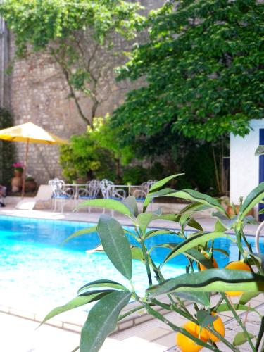 The swimming pool at or near Hôtel Le Yachtman