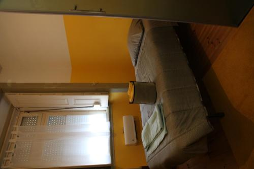 A bed or beds in a room at CSI Coimbra & Guest House - Student accommodation