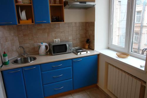 Кухня или мини-кухня в Teren Plus