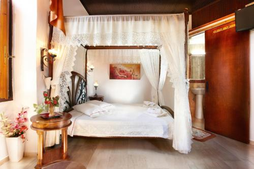 A bed or beds in a room at Archontiko Evgenia Studios