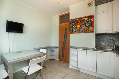 A kitchen or kitchenette at Apartments in Krylatskoye