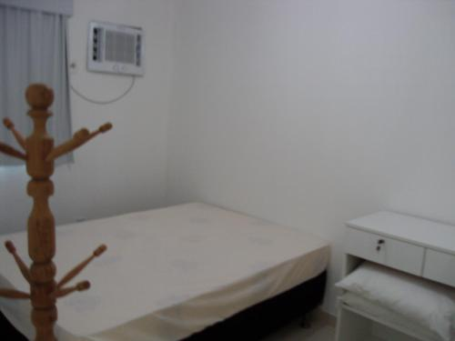A bed or beds in a room at Flat Porto dos Carneiros