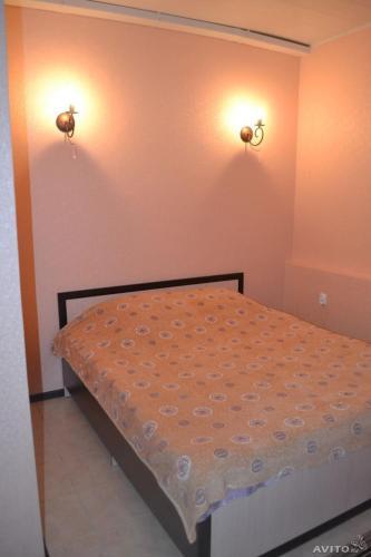 Кровать или кровати в номере Отель Александра