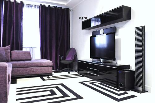 A television and/or entertainment center at International Apartment