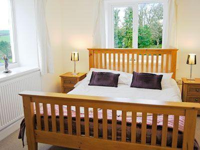 A bed or beds in a room at Lowen
