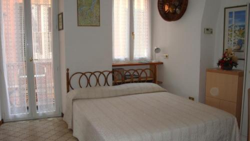 A bed or beds in a room at Bellagio Center Apartment n°12