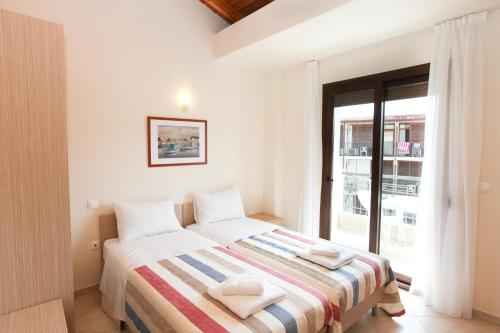 A bed or beds in a room at Skiathos Somnia