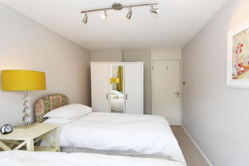 A bed or beds in a room at West Kensington