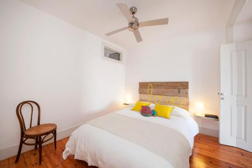 A bed or beds in a room at Rossio - Chiado | Lisbon Cheese & Wine Apartments