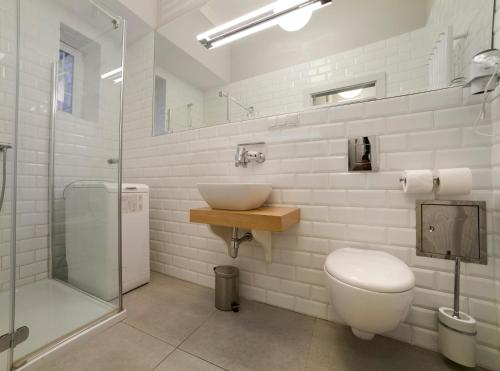 A bathroom at Patio Apartments - Old Town