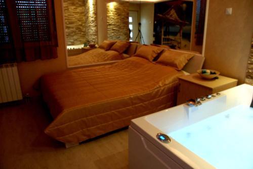 Krevet ili kreveti u jedinici u okviru objekta Spa Secret Apartments
