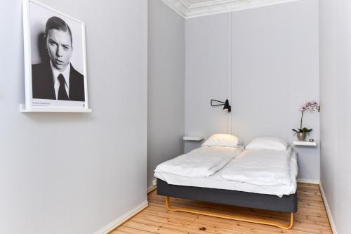 A bed or beds in a room at Forenom Serviced Apartments Oslo Royal Park