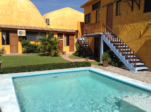 The swimming pool at or near Las Casitas