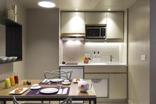 A kitchen or kitchenette at Citadines Opéra Paris