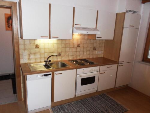 A kitchen or kitchenette at Haus Konzett