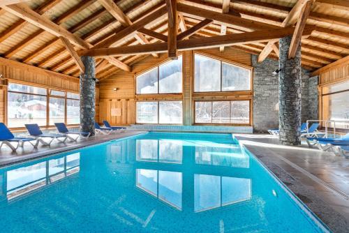 The swimming pool at or near Lagrange Vacances Le Hameau du Rocher Blanc
