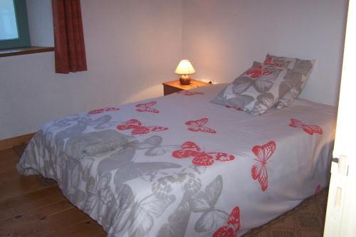 Un ou plusieurs lits dans un hébergement de l'établissement Domaine de Salomony