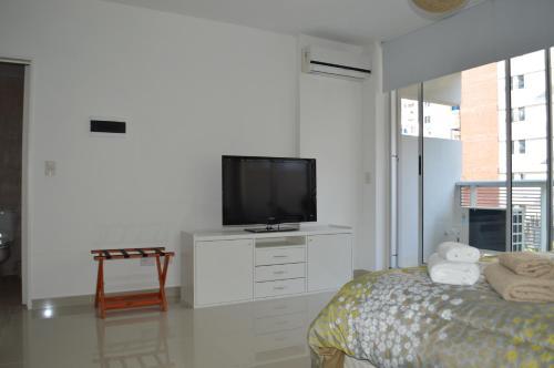 A television and/or entertainment centre at Apartamento Ocio