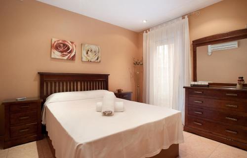 A bed or beds in a room at Gracia NextDoor 2