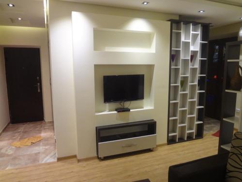 A television and/or entertainment center at Studio-Apartment Komitas