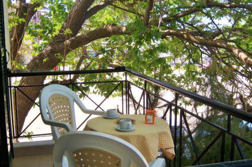 A balcony or terrace at Melina Apartment
