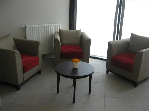 A seating area at Domitys Le Parc Balsan