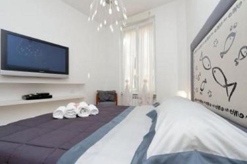 A bed or beds in a room at Karol Apartament Rome