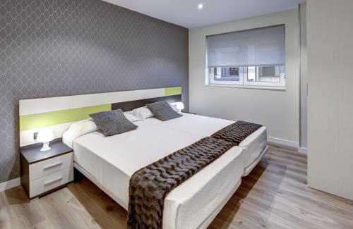 Cama o camas de una habitación en Apartamentos La Albarca