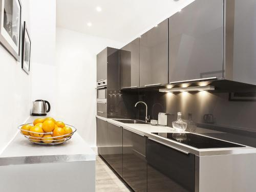 A kitchen or kitchenette at The Residence - Luxury 2 Bedroom Paris Center