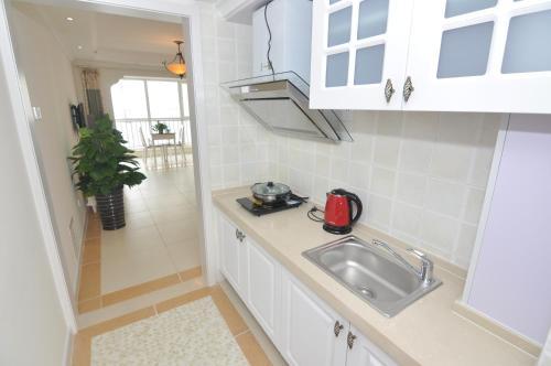 A kitchen or kitchenette at Xiadu Coast B Block Aparthotel