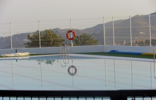 The swimming pool at or near Real House