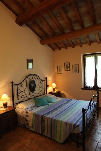 A bed or beds in a room at Agriturismo Biologico Villa Rosa