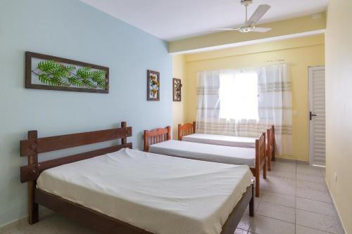 A bed or beds in a room at Apartamentos Praia da Maranduba