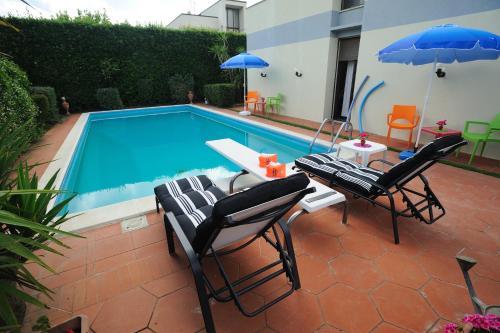 The swimming pool at or near Villa La Certosa