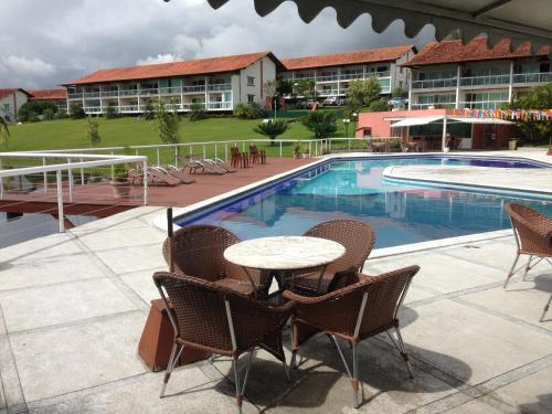 The swimming pool at or near Flat 608 Villa Hípica - Gravatá