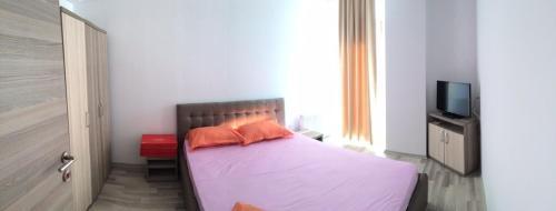 Un pat sau paturi într-o cameră la Studio Andra