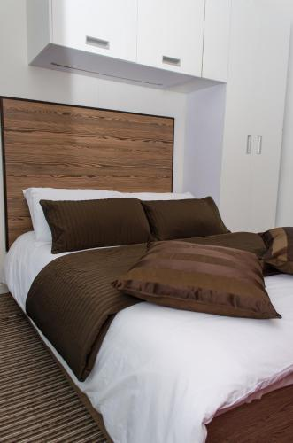 A bed or beds in a room at Trivelles - Bradford - Sunbridge Road
