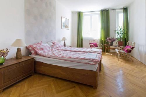 A bed or beds in a room at Apartment Heart Of Budapest