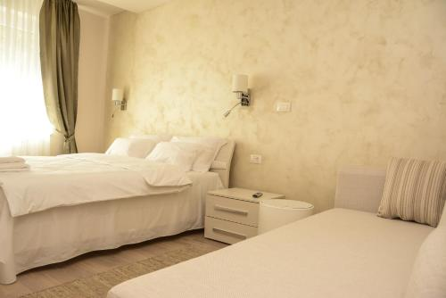 A bed or beds in a room at Apartment Venera A&M
