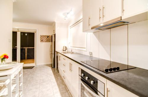 A kitchen or kitchenette at Terrace on Walbourne