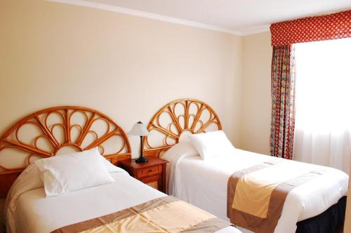 A bed or beds in a room at Apart Hotel Florencia